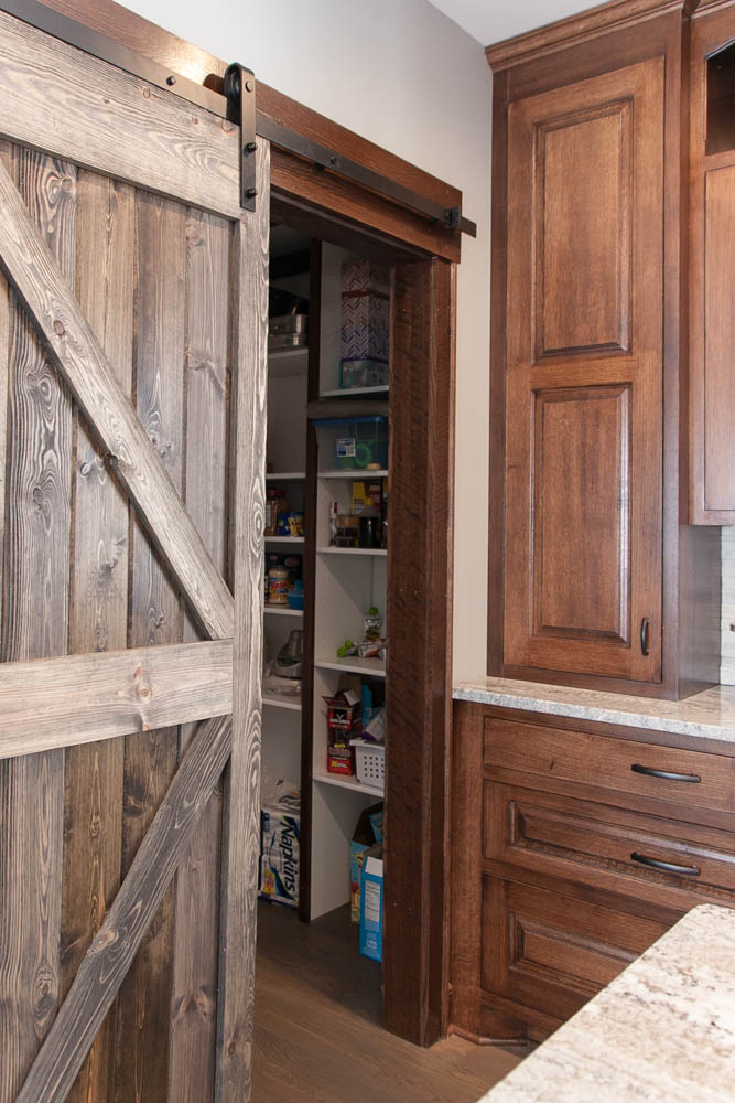 Off Of The Kitchen Same Oak White And Rustic Wood Finish Carries Into Basement Garage Backyard Exit Stairwell