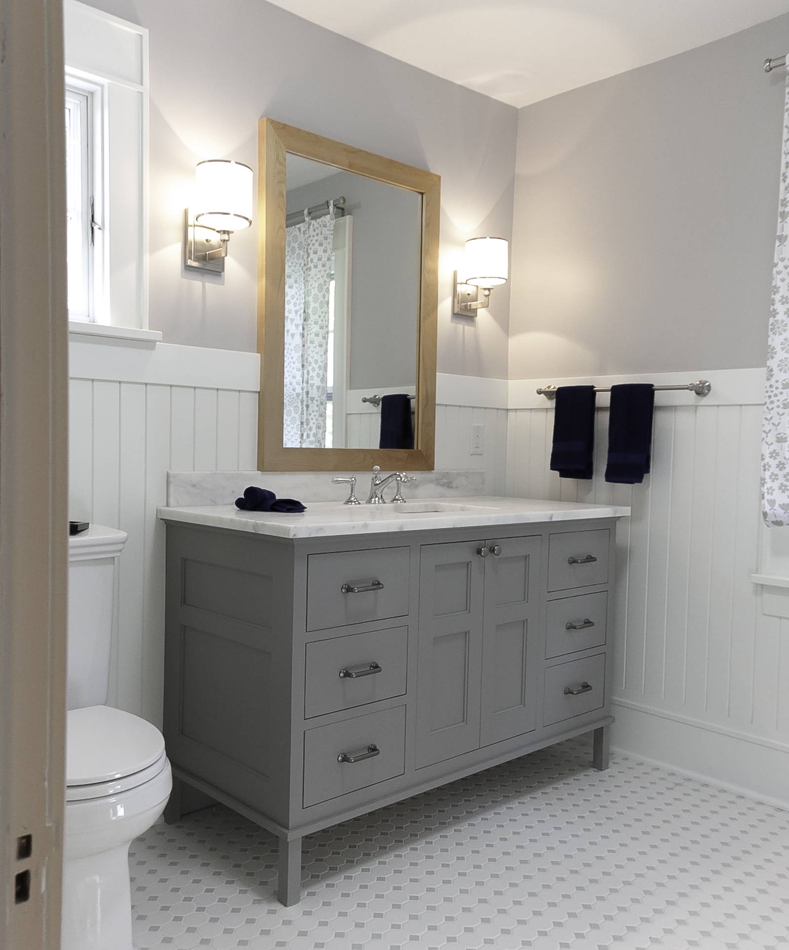 the bathroom vanity was built with shaker style doors and inset