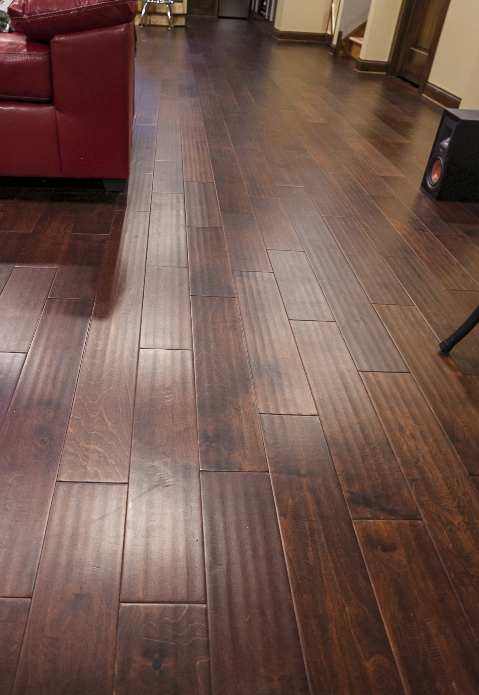 Dark Laminate Flooring Mirrors The Natural Hickory In Kitchen Adding Contrast And Warmth To Room