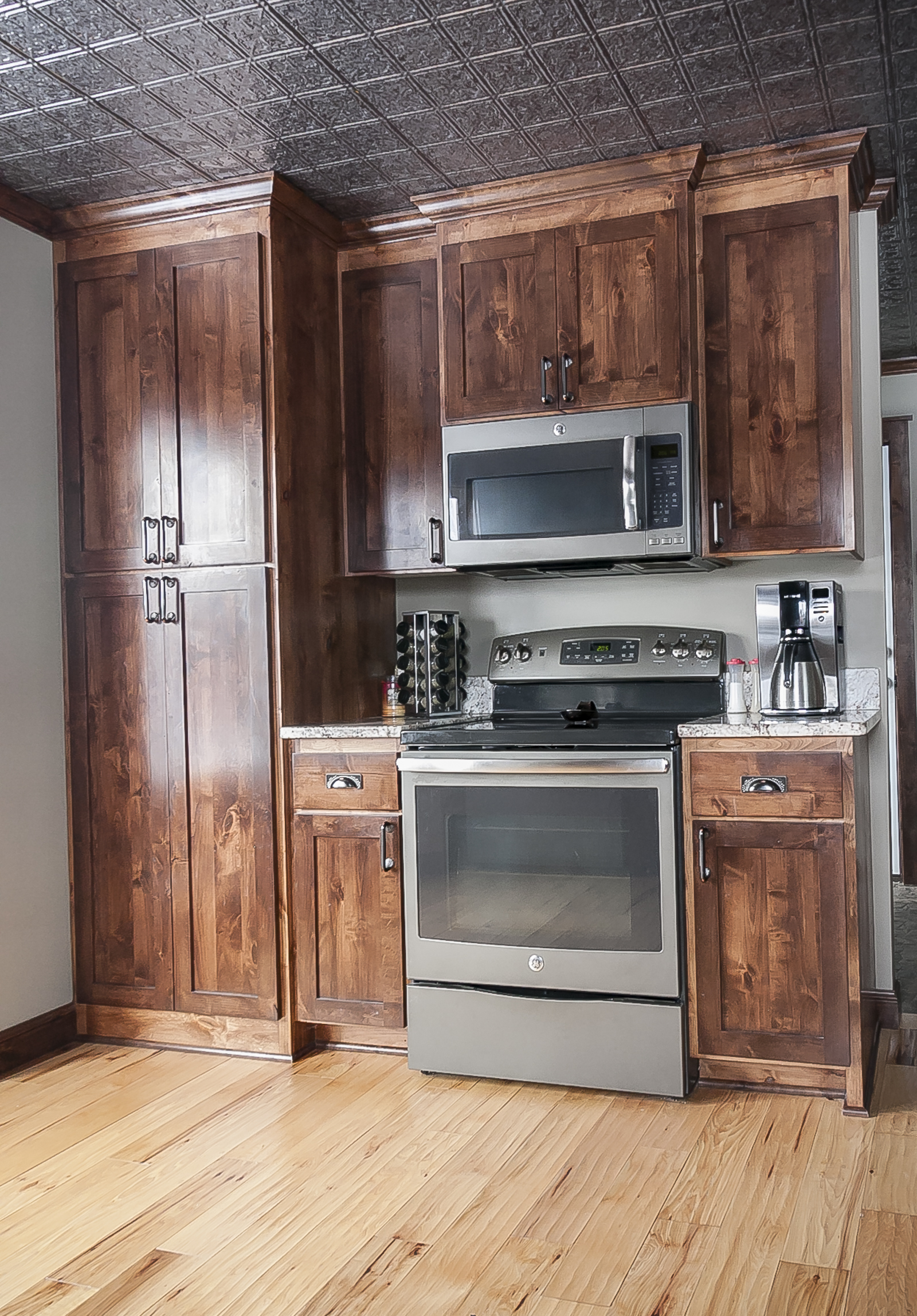Rustic Alder Shaker Style Cabinetry Tin Ceiling Tiles And Hammered Copper Acents Are Charming Farmhouse Features Adding So Much Character Texture To