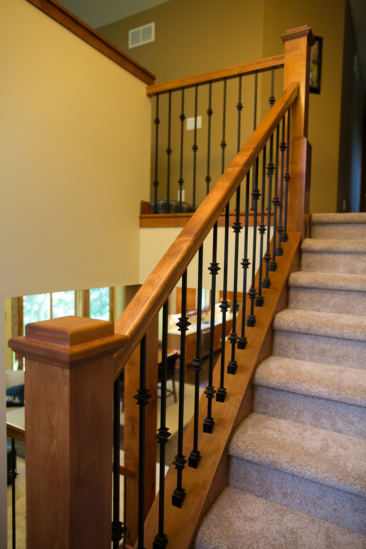 New Home Construction Ramsey MN Custom Cabinetry Wrought Iron Staircase
